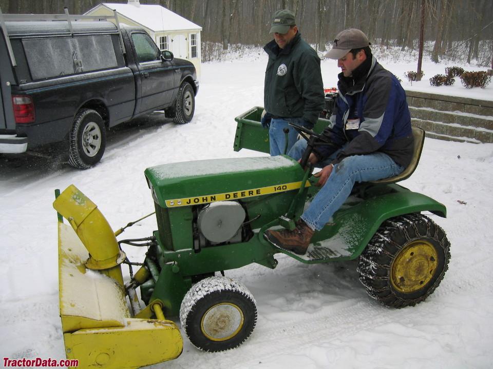 Snow blower mounted on the John Deere 140.