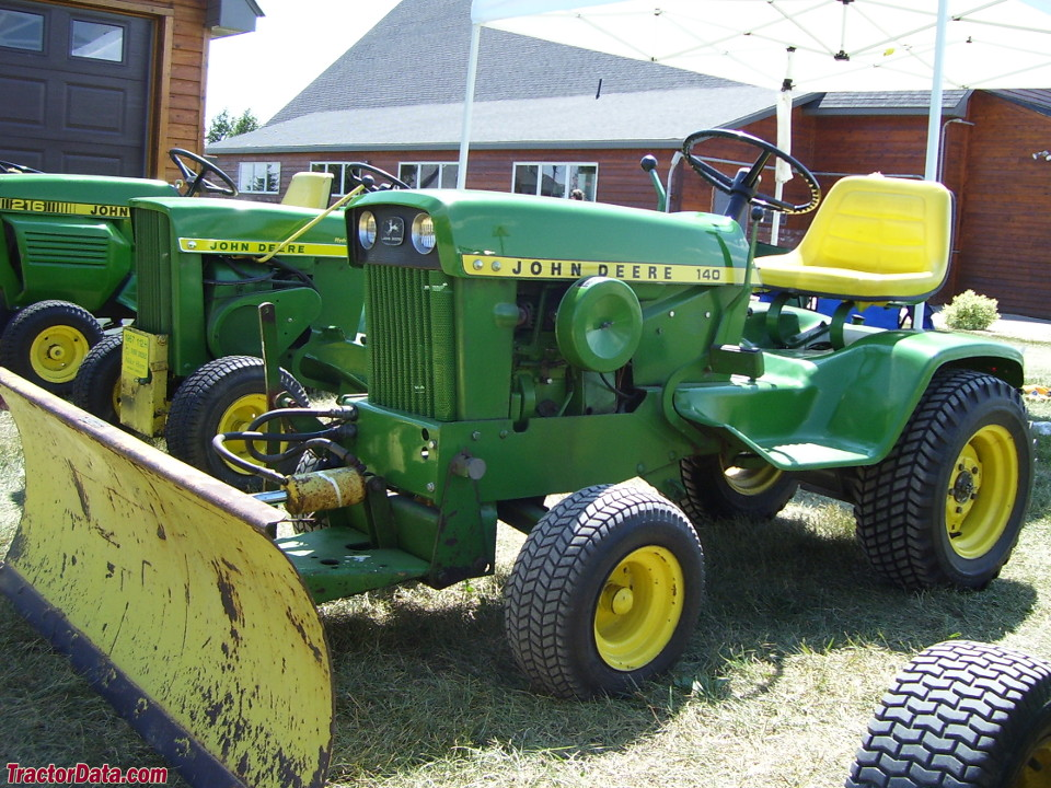 John Deere 140 with hydraulic front blade.