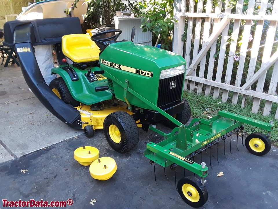 John Deere 170 with bagger, thatcher, and wheel weights.