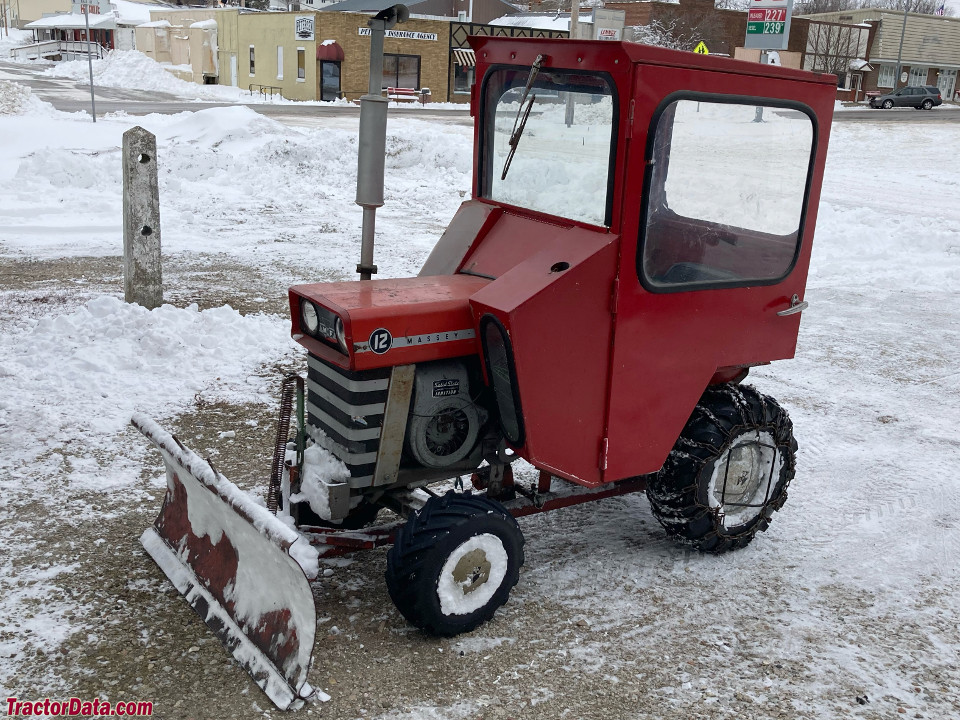 Massey Ferguson 12 with Cozy Cab and front blade.