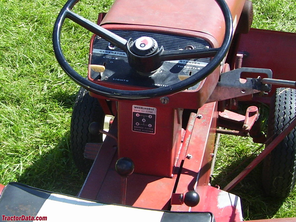 Wheel Horse 1054 operator station and controls.