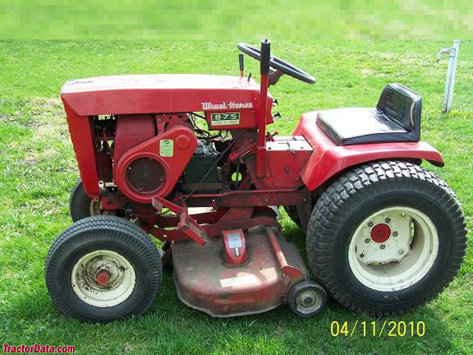 Wheel Horse 875 with rotary mower, left side.