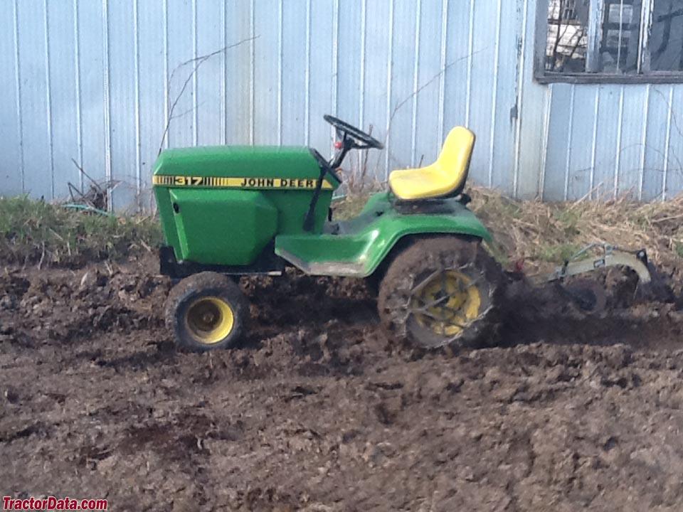 John Deere 317 with plow, left side