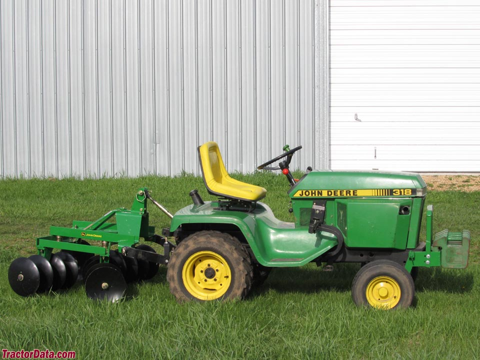 John Deere 318 with disc, right side.