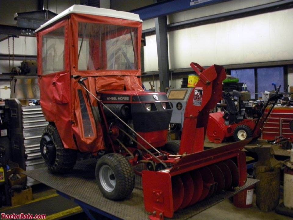 Wheel Horse 314-8 with snowblower and weather cab.