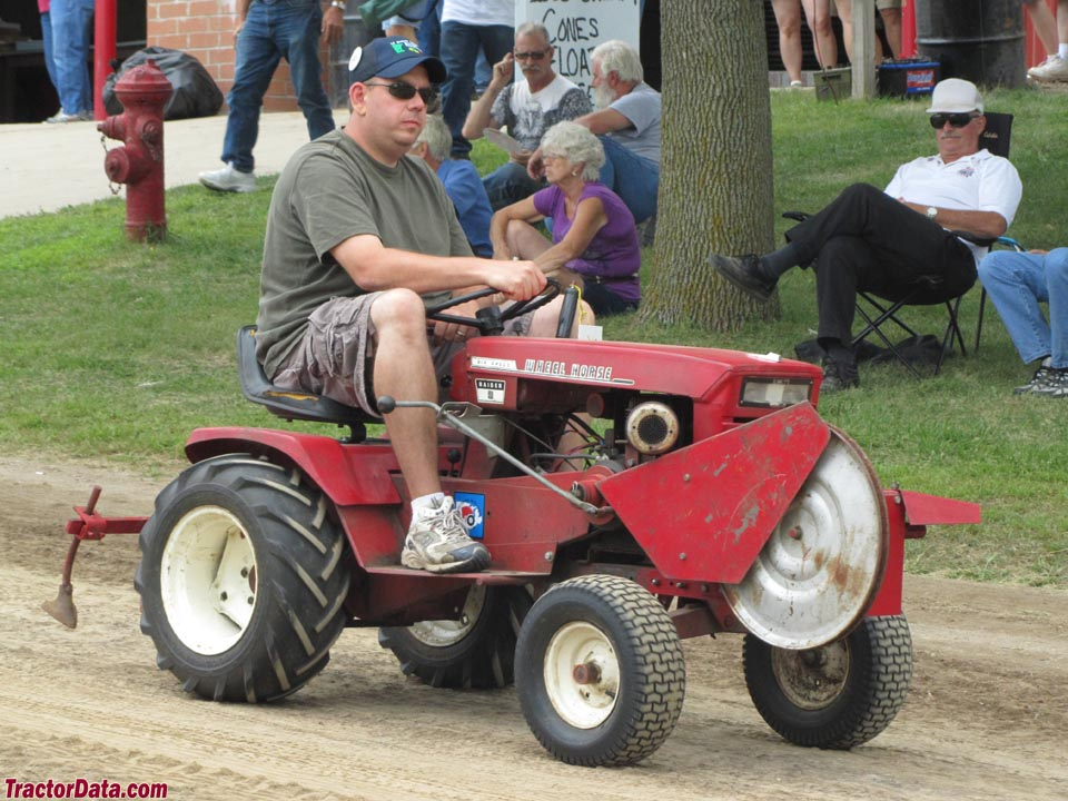 Wheel Horse Raider 9 with front PTO and rear cultivator, right side.