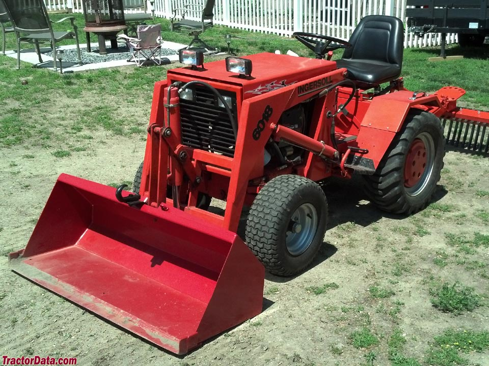 Ingersoll 6018 with front-end loader and landscape rake.