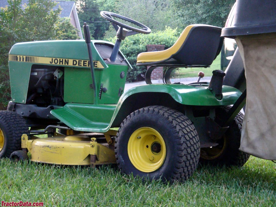 John Deere 111H with mower and rear bagger.