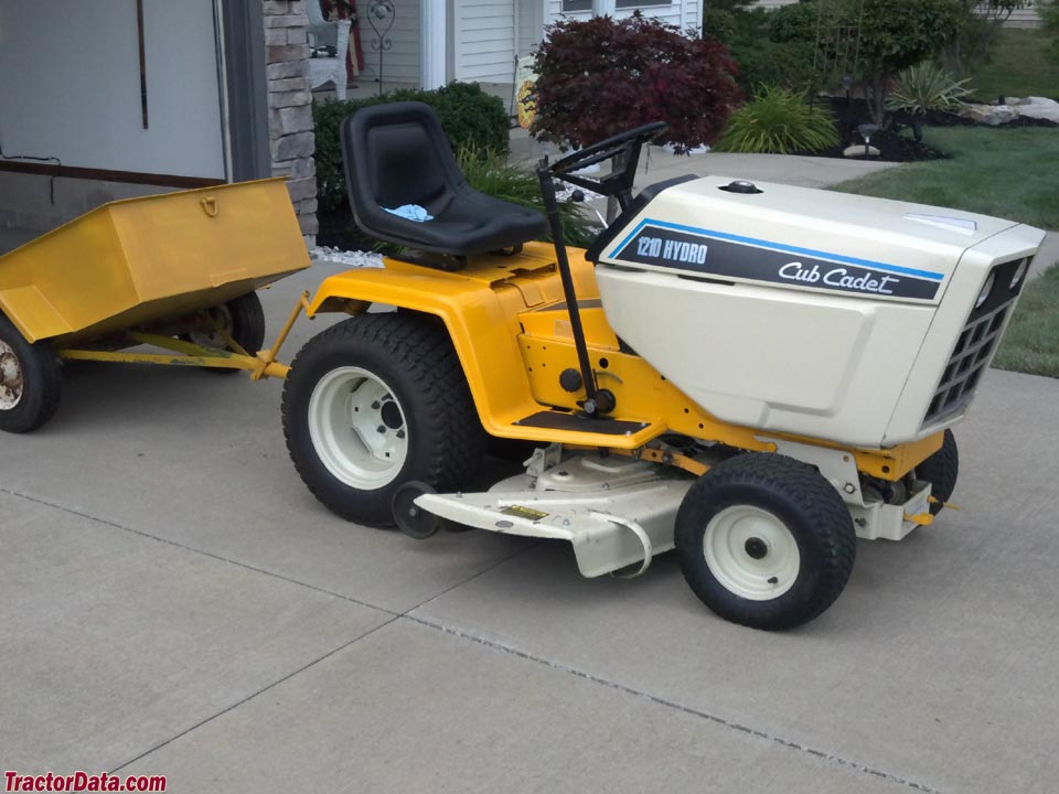 Cub Cadet 1210 with dump cart.
