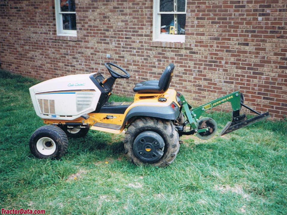 Cub Cadet 2086 with three-point mounted plow.