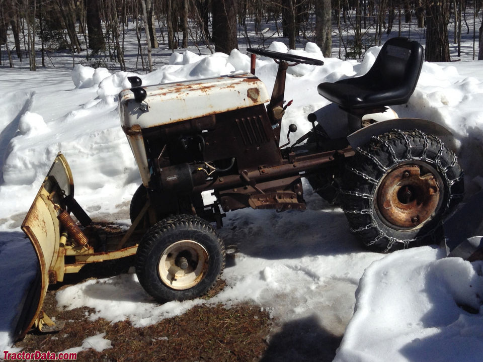 Bolens 900 with a front-mount plow.