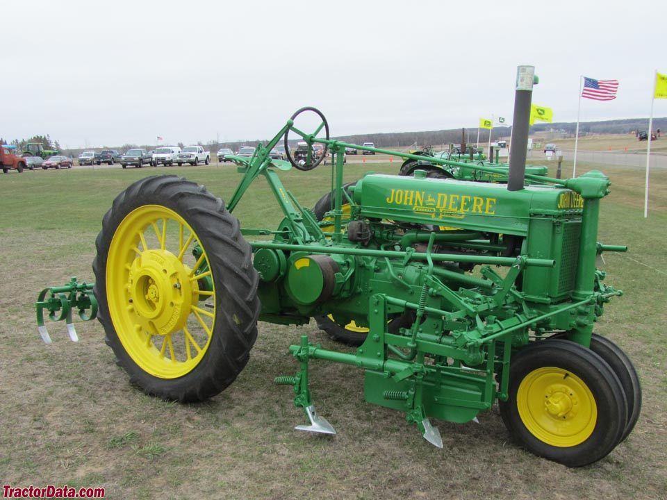 Unstyled John Deere B with mounted cultivators.