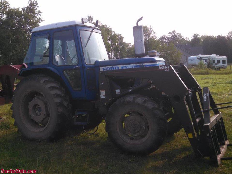 Four-wheel drive Ford 6700 with cab and Buhler model 595 loader.