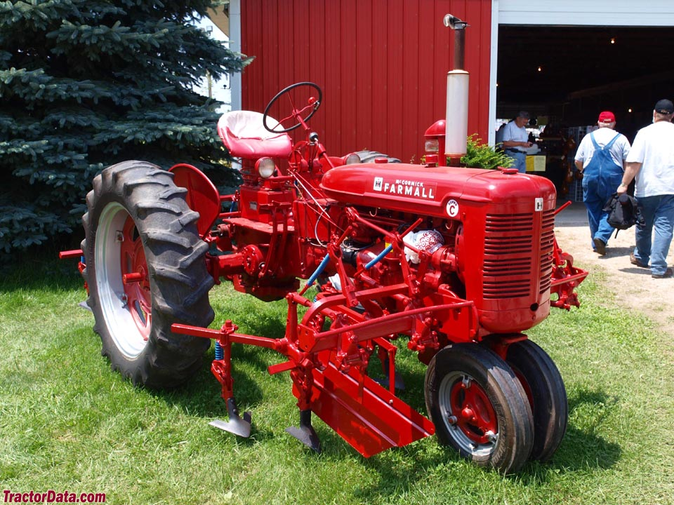 Farmall Super C with mounted cultivators.