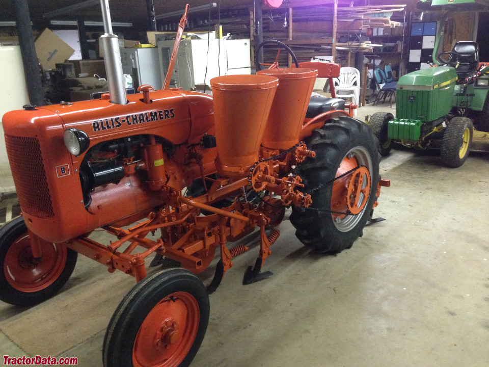 Allis-Chalmers B with 60 series cultivators and 601A planter/fertilizer side dresser.