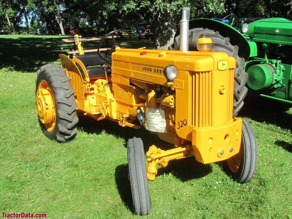 John Deere 320U utility in industrial yellow