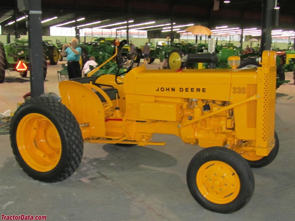 John Deere 330U in industrial yellow.