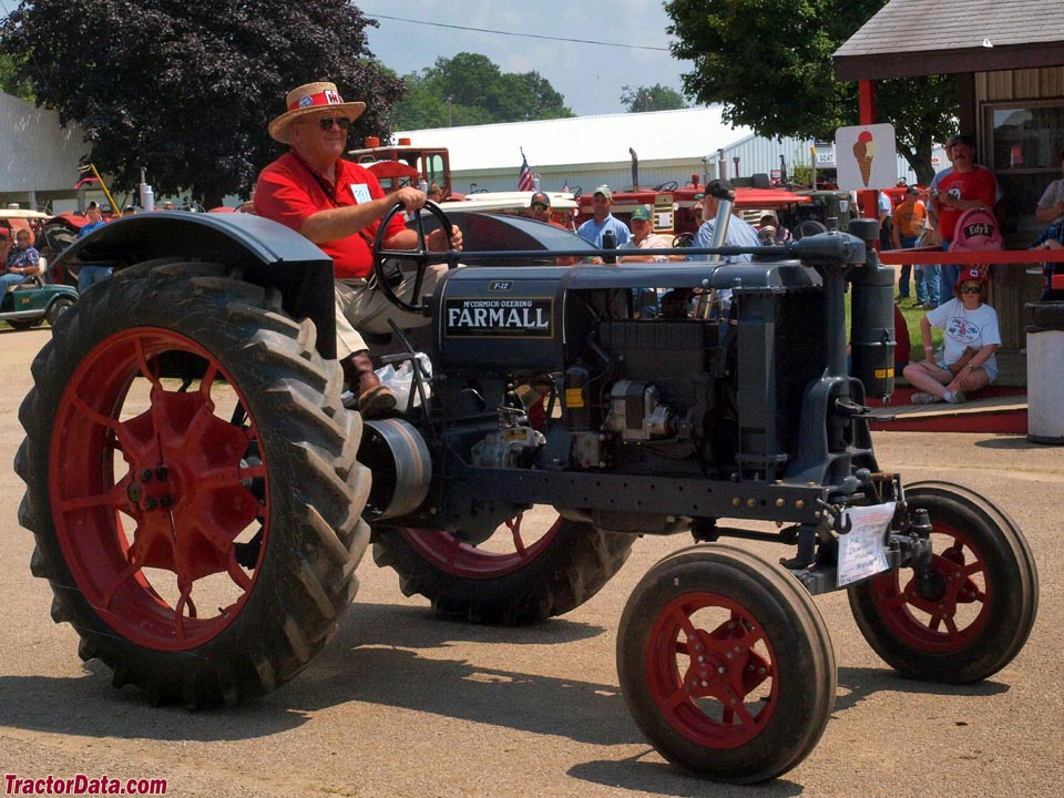 Gray Farmall F-12 with wide-front end.