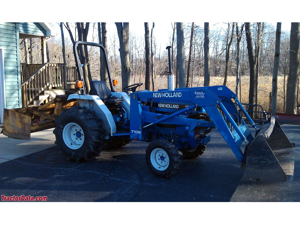 New Holland 1620 with box blade and model 7108 loader.