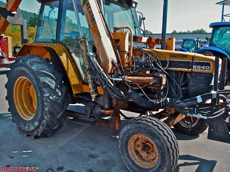 Ford-New Holland 6640 with boom mower