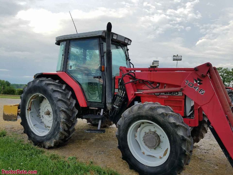 Massey Ferguson 6180 with 1048 front-end loader.