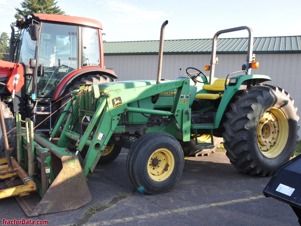 John Deere 5500 with ROPS and 520 loader.