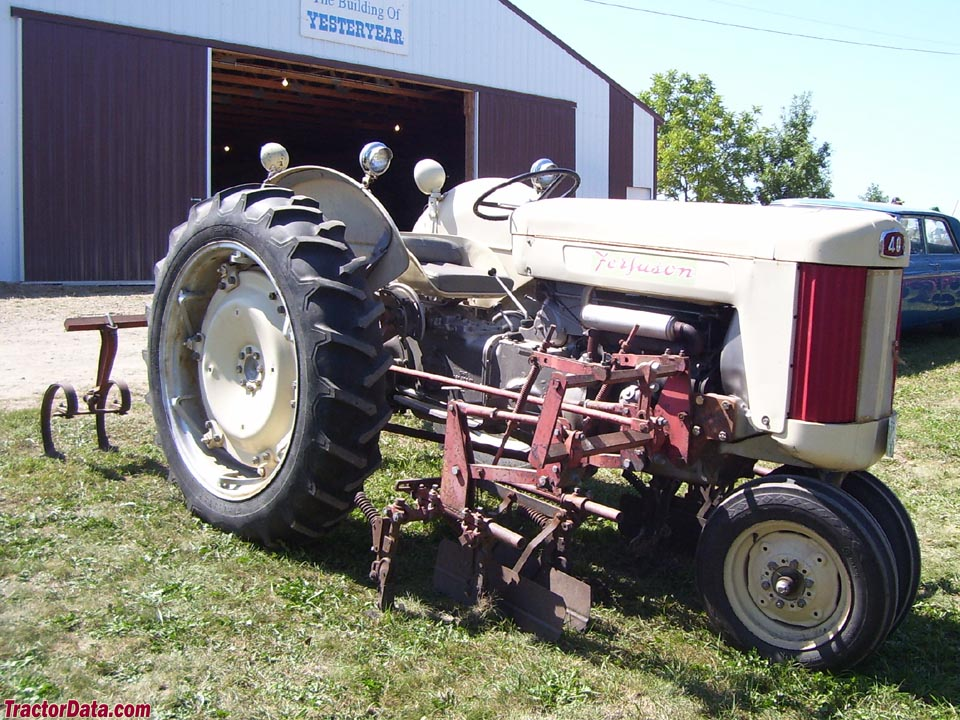 Ferguson F-40 row-crop with tricycle front end and mounted cultivators.