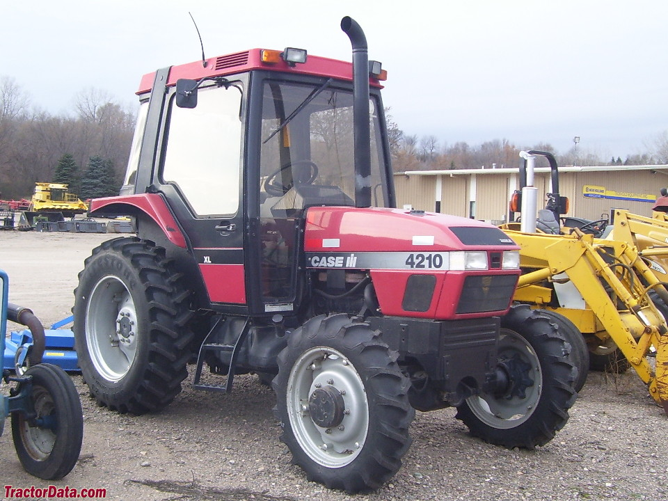 Case IH 4210 utility with cab and four-wheel drive.