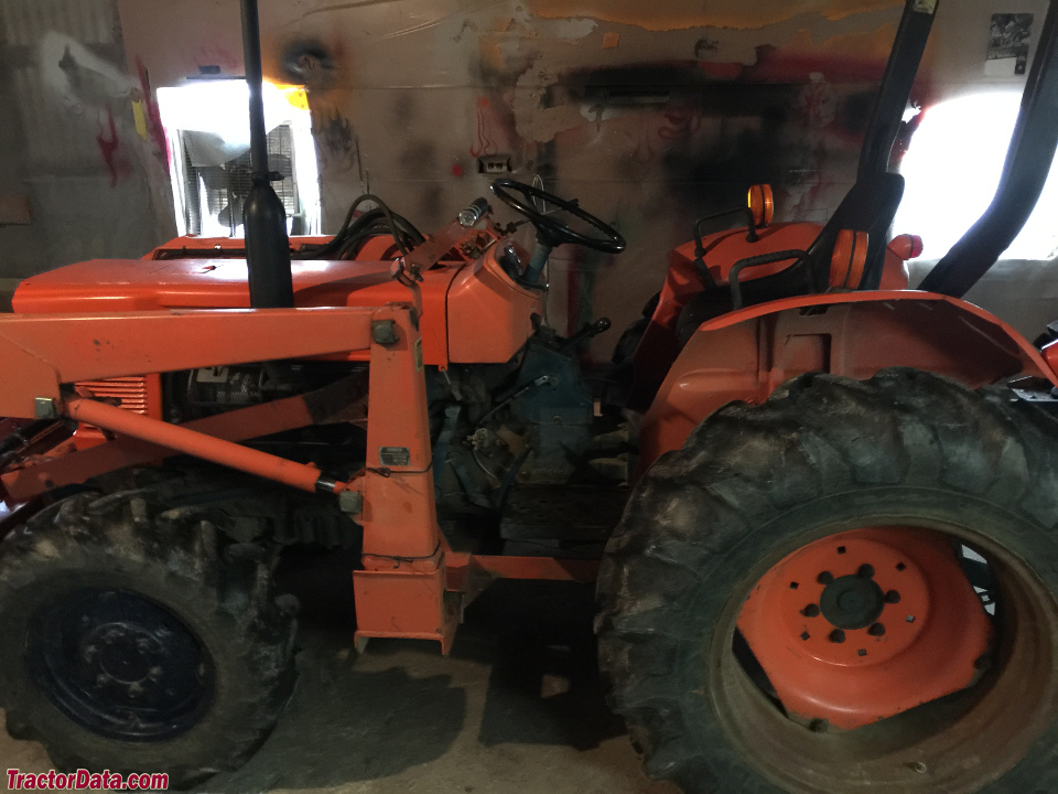 Kubota L275 with front-end loader.