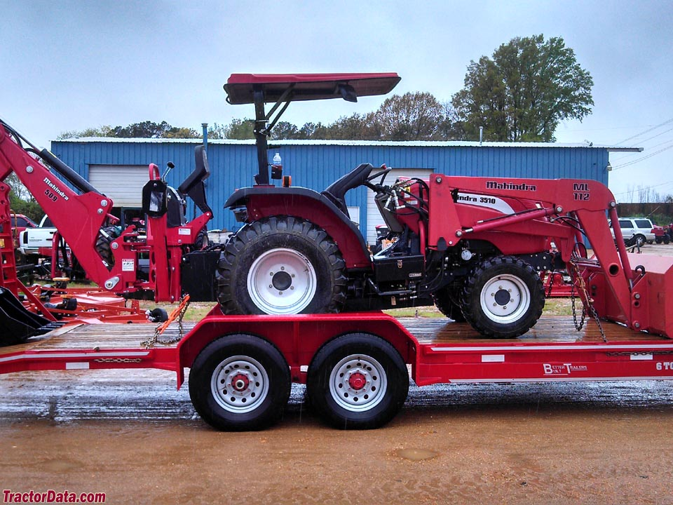 Mahindra 3810 with ML112 front-end loader and 509 backhoe, right side.