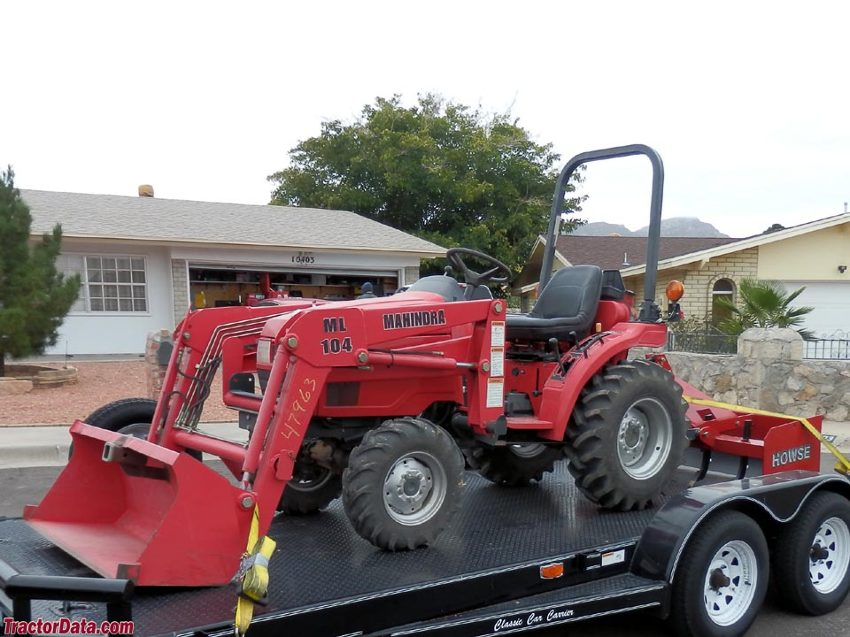 Mahindra 2015 with front-end loader and box blade.