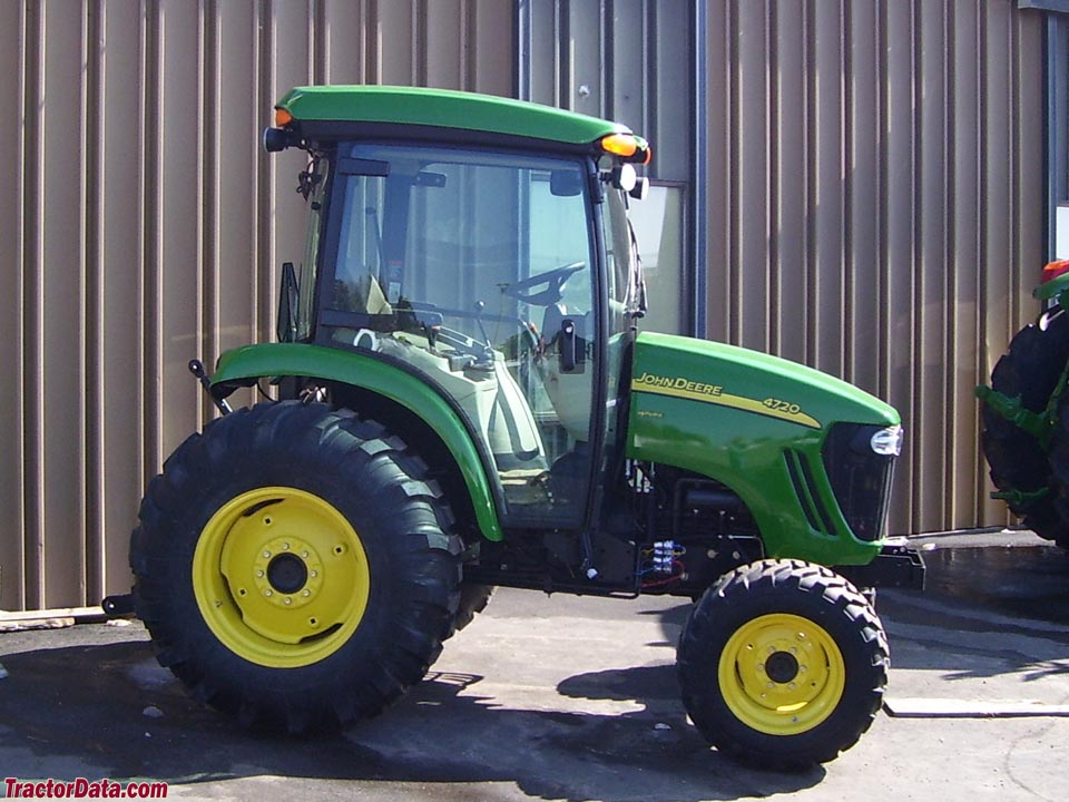 John Deere 4720 utility tractor with cab.