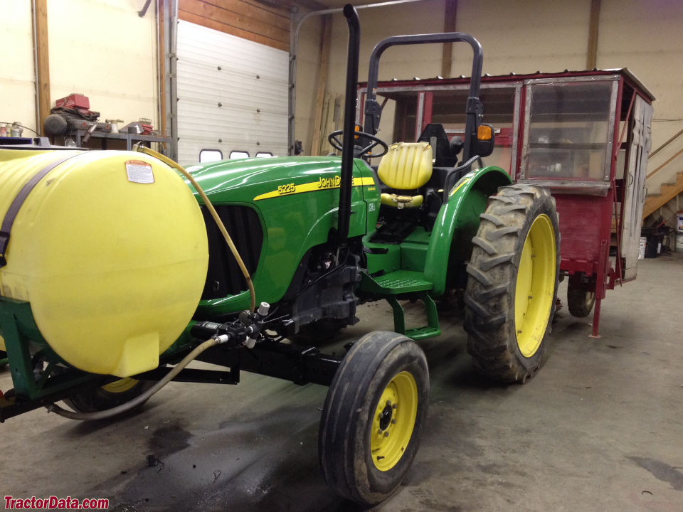 John Deere 5225 with two-wheel drive and ROPS.