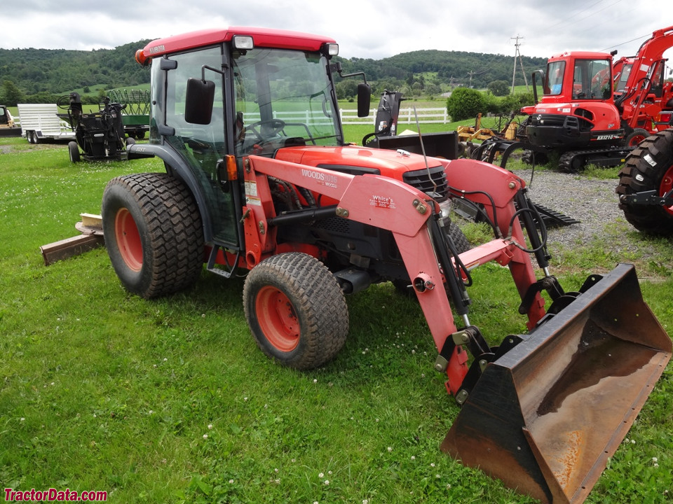 Kubota L4330 with cab and front-end loader.