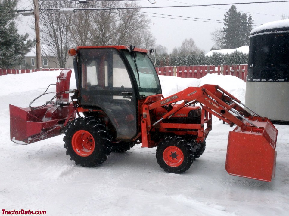 2005 Kubota B7610 with LA302 front-end loader, Curtis cab, and rear snow blower.