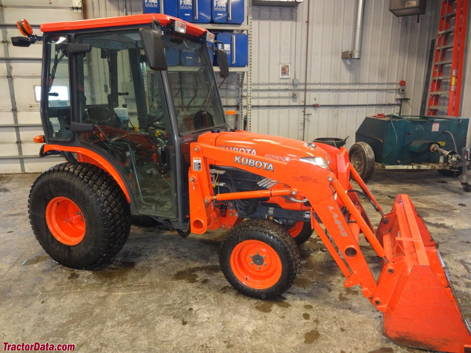Kubota B3030 with cab and LA403 front-end loader.