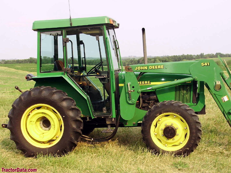 Four-wheel drive John Deere 5410 with cab and model 541 loader.