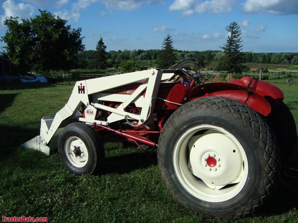 Restored International 434 with front-end loader.