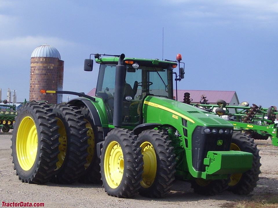 John Deere 8530 with rear triples and front duals.