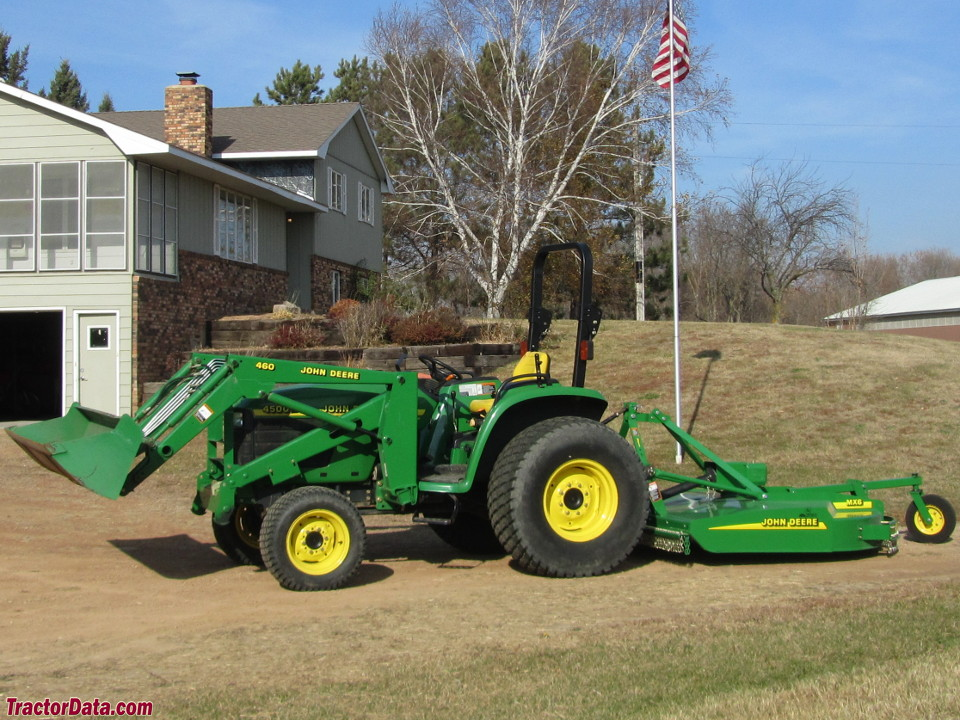John Deere 4500 with model 460 front-end loader and MX6 rotary cutter.