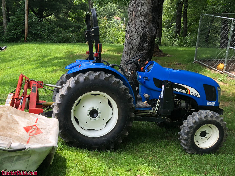 New Holland TC55DA with sickle mower, right side.