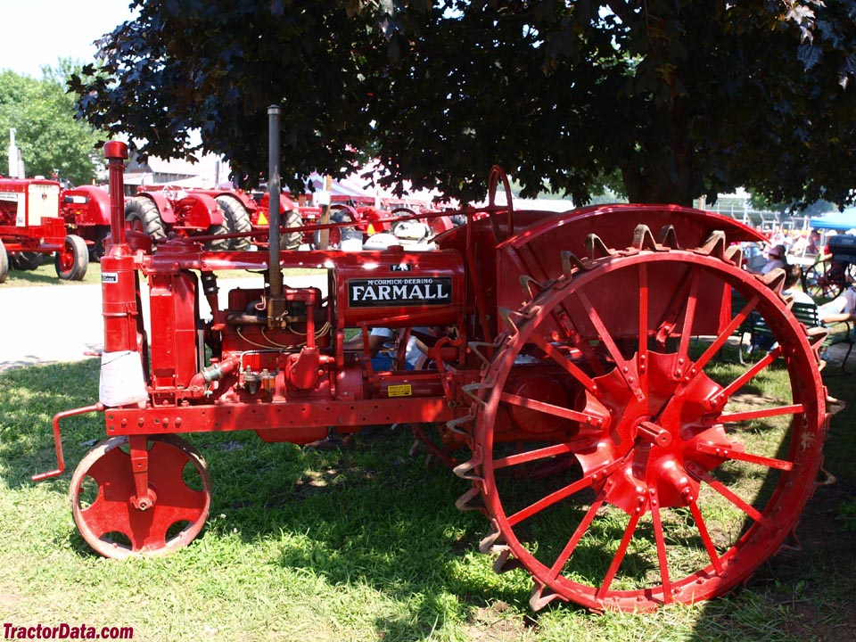 Farmall F-14 with front and rear steel wheels, left side.