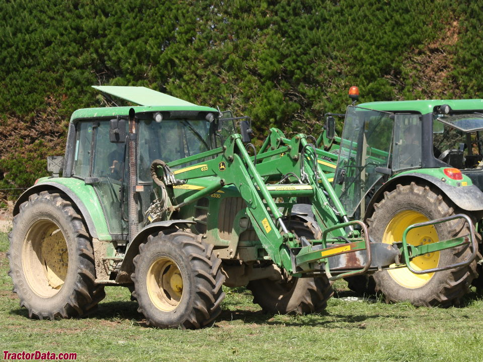 John Deere 6330 with cab and model 633 front-end loader.