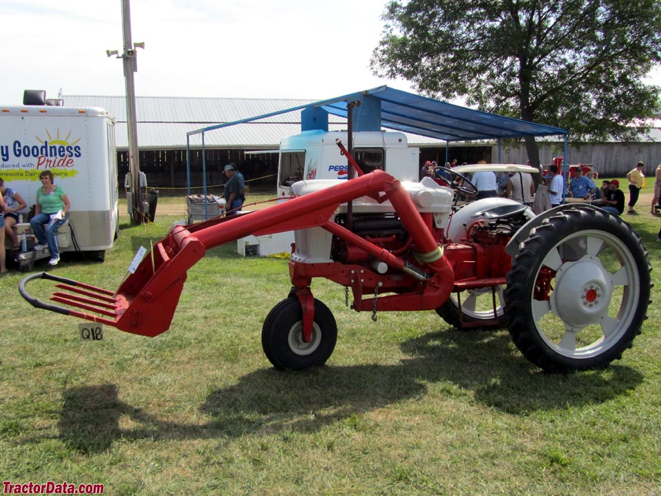 Ford 940 with single-front wheel and one-arm front-end loader.
