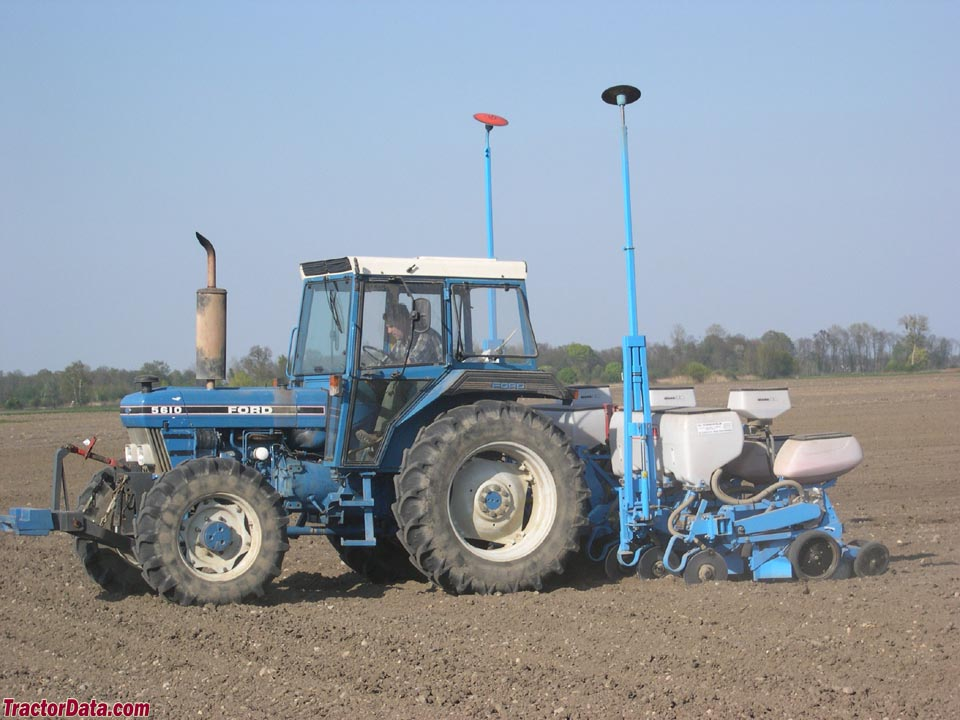 Ford 5610 Series II with planter.