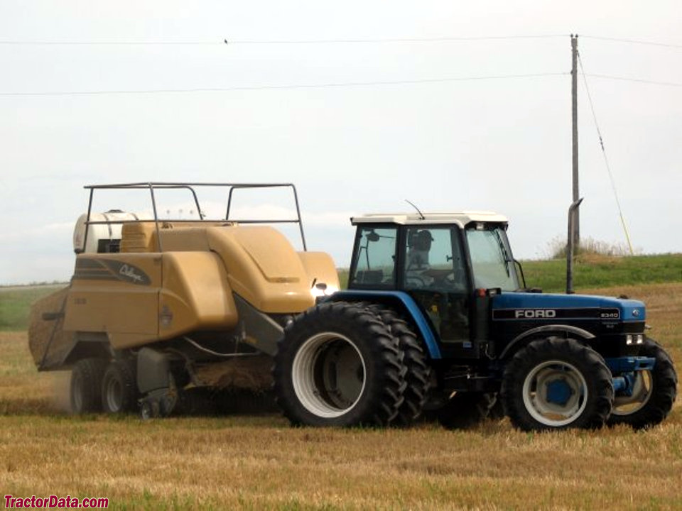 Ford 8340 with baler, right side.