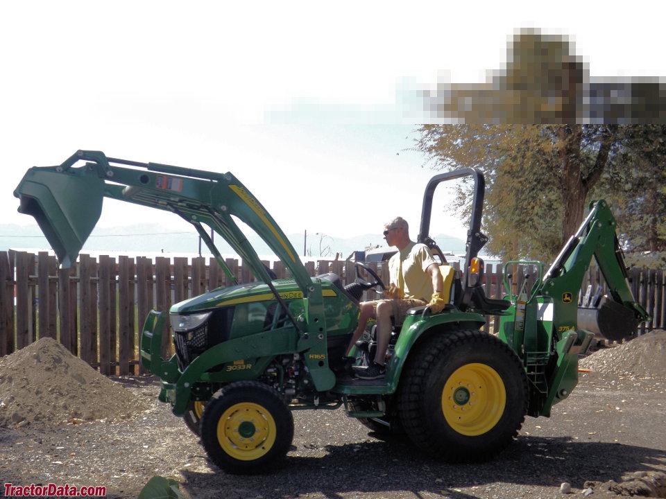 John Deere 3033R with loader and backhoe.